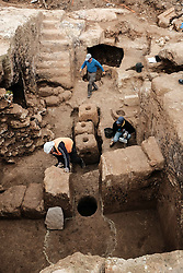 March 27, 2019 - Jerusalem, Israel - A 2000-year-old Hasmonean period, 2nd temple era, Jewish village of agricultural nature, has been uncovered in excavations conducted in the Sharafat neighborhood of Jerusalem. Excavations have yielded remains of a large wine press containing fragments of many storage jars, a large columbarium cave (rock cut dovecote), an olive press, a large ritual bath (mikveh), a water cistern, rock quarries and installations. The most significant find is an extravagant burial estate, which included a corridor leading to a large courtyard chiselled into the bedrock. (Credit Image: © Nir Alon/ZUMA Wire)