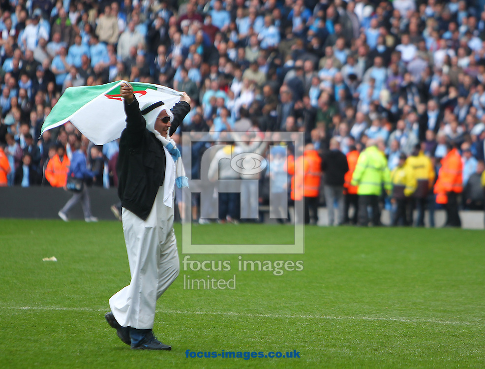 Manchester City fans celebrate winning the Barclays Premier League on the pitch at the Etihad Stadium, Manchester<br /> Picture by John Rainford/Focus Images Ltd +44 7506 538356<br /> 11/05/2014