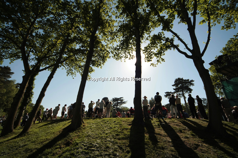 25.05.2012 Wentworth, England. View of the 18th green as the sun filters down low during the BMW PGA Championship.