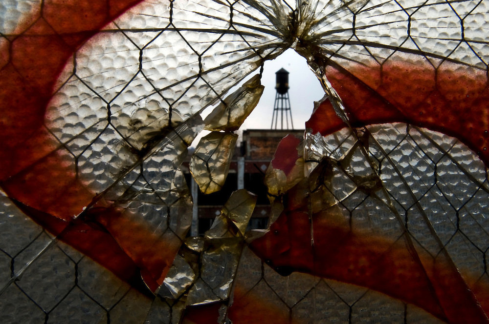 """View through a broken window at the Packard Motors factory in Detroit, MI. Detroit is a part of America's Midwestern """"Rust Belt"""", the heartland of the country and home to big unionized manufacturers like the auto and steel industries"""