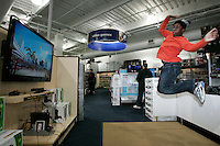 Cambridge, MA - Ivan Norman, 14 of Cambridge, plays a volleyball game on the Kinect controler for the Xbox 360 at Best Buy on December 3, 2010.   Photo by Matthew Healey