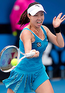 Jie Zheng (CHN)<br /> 2010 Australian Open Tennis<br /> Womens Singles<br /> First Round<br /> 18/01/10<br /> Jie Zheng of China hitas a forhand return during her first round win against Shuai Peng of China 0-6 6-1 6-2<br /> &quot;Court 8&quot; Melbourne Park, Melbourne, Victoria, Australia<br /> Photo By Lucas Wroe
