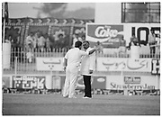England captain Mike Gatting  pursues his confrontation with Pakistan Umpire Shakoor Rana during the 2nd Test Match, Pakistan v England at the Iqbal Stadium Faisalabad, 8.12.1987. Photograph: Graham Morris/cricketpix.com (Tel: +44 (0)20 8969 4192; Email: sales@cricketpix.com) Ref. No. 87663b16