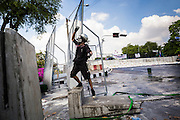01 DECEMBER 2013 - BANGKOK, THAILAND: A Thai anti-government protestor screams at riot police after they used tear gas against a crowd in Bangkok. Thousands of anti-government Thais confronted riot police at Phanitchayakan Intersection, where Rama V and Phitsanoluk Roads intersect, next to Government House (the office of the Prime Minister). Protestors threw rocks, cherry bombs, small explosives and Molotov cocktails at police who responded with waves of tear gas and chemical dispersal weapons. At least four people were killed at a university in suburban Bangkok when gangs of pro-government and anti-government demonstrators clashed. This is the most serious political violence in Thailand since 2010.    PHOTO BY JACK KURTZ
