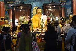 May 10, 2017 - Kolkata, India - Indian Buddhist devotees leave offerings and offer prayers at a statue of the Buddha during celebrations to mark Buddha Purnima at The Mahabodhi Society in East India city Kolkata on May 10, 2017, (Credit Image: © Debajyoti Chakraborty/NurPhoto via ZUMA Press)