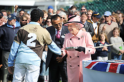 Left to right, MR TARIQ AL HABTOOR (nr 2) HM THE QUEEN and MR KHALAF AL HABTOOR (in waistcoat) at Al Habtoor Royal Windsor Cup Final 2012 at Guards Polo Club, Berkshire on 24th June 2012.