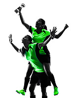 two women playing soccer players in silhouette isolated on white background