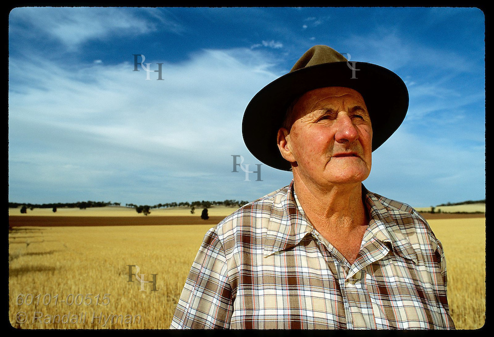 Farmer Jack Veitch surveys fields of alfalfa stubble on his farm in Coolamon, New South Wales. Australia