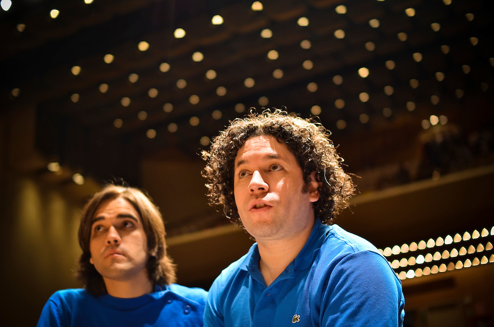 Sergio Rosales, 23, at rehearsal with Gustavo Dudamel in Caracas, Venezuela.  Rosales joined El Sistema when he was ten years old, and is now a promising young conductor.  The Simon Bolivar orchestra, formerly a youth orchestra, is now a full-fledged adult ensemble, and a world-class one. Conductors and players it has trained are spreading out into the international classical world.