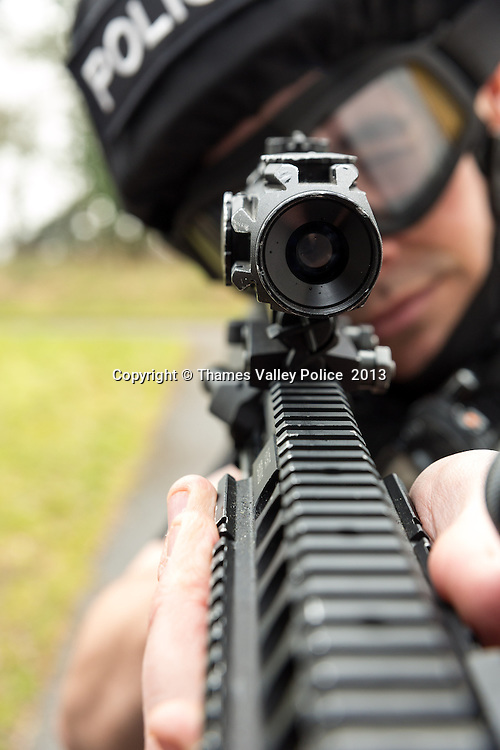 Firearms officers of the Joint Operations Unit photographed in the practice houses at Sulhamstead. Thames Valley Police and Hampshire Constabulary combined their ARV Firearms teams into a single operational unit in 2012.  Reading, UNITED KINGDOM. March 07 2013. <br /> Photo Credit: MDOC/Thames Valley Police<br /> &copy; Thames Valley Police 2013. All Rights Reserved. See instructions.