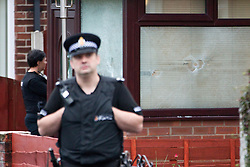 © Licensed to London News Pictures. 27/09/2012. Salford , UK . Police at the scene of a house on 5 Acresfield Road , Salford , where bullets were fired in to the front porch window . Photo credit : Joel Goodman/LNP