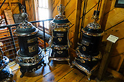 Parlor stoves, 1870s-1910. San Juan County Historical Society Museum, Silverton, Colorado, USA. Silverton is a former silver mining camp, now the federally-designated Silverton Historic District. Durango is linked to Silverton by the Durango and Silverton Narrow Gauge Railroad, a National Historic Landmark. Silverton no longer has active mining, but subsists on tourism, maintenance of US 550 (which links Montrose with Durango), mine pollution remediation, and retirees.