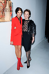 Left to right, Giovanna Battaglia  and Victoria Fernandez at a private view of Nicolas Pol's paintings entitled 'Mother of Pouacrus' held at The Dairy, Wakefield Street, London WC1 on 14th October 2010.