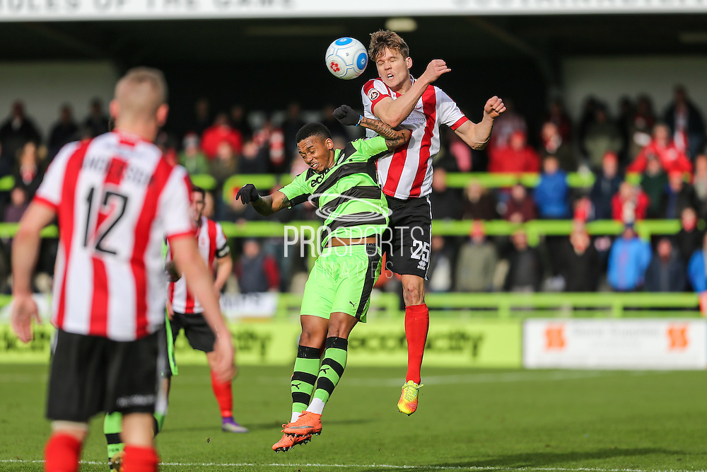 Lincoln City's Sean Raggett out jumps Forest Green Rovers Keanu Marsh-Brown(7) during the Vanarama National League match between Forest Green Rovers and Lincoln City at the New Lawn, Forest Green, United Kingdom on 19 November 2016. Photo by Shane Healey.