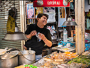 29 JUNE 2015 - BANGKOK, THAILAND: A vendor sells Thai desserts in Bang Chak Market in Bangkok. The Bang Chak Market serves the community around Sois 91-97 on Sukhumvit Road in the Bangkok suburbs. About half of the market has been torn down, vendors in the remaining part of the market said they expect to be evicted by the end of the year. The old market, and many of the small working class shophouses and apartments near the market are being being torn down. People who live in the area said condominiums are being built on the land.      PHOTO BY JACK KURTZ