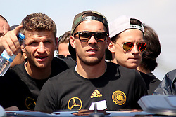 15.07.2014, Brandenburger Tor, Berlin, GER, FIFA WM, Empfang der Weltmeister in Deutschland, Finale, im Bild Die deutsche Fussball-Nationalmannschaft faehrt in einem offenen Riesenlaster zur Fanmeile.v.l.Thomas Mueller (GER), Lukas Podolski (GER) und Julian Draxler (GER) // during Celebration of Team Germany for Champion of the FIFA Worldcup Brazil 2014 at the Brandenburger Tor in Berlin, Germany on 2014/07/15. EXPA Pictures © 2014, PhotoCredit: EXPA/ Eibner-Pressefoto/ Pool<br /> <br /> *****ATTENTION - OUT of GER*****