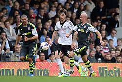Stoke City's Jonathan Walters, Fulham's Fernando Amorebieta and Stoke City's Stephen Ireland compete for the ball - Photo mandatory by-line: Mitchell Gunn/JMP - Tel: Mobile: 07966 386802 05/10/2013 - SPORT - FOOTBALL - Craven Cottage - London - Fulham V Stoke City - Premiership