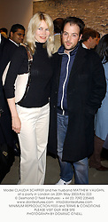Model CLAUDIA SCHIFFER and her husband MATTHEW VAUGHN, at a party in London on 20th May 2003.PJU 223