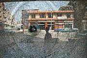 Bullet holes in the Syria Street, on the front line separating the Sunni neighborhood Bab al-Tebbaneh and Alawite Jabal Mohsen. Tripoli, Lebanon..Impacts de balles dans la Rue de Syrie, la ligne de front séparant les quartiers sunnite Bab al-Tebbaneh et alaouite Jabal Mohsen.