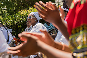 Descendants of enslaved Africans brought to Charleston in the Middle Passage sing praise songs during a remembrance ceremony at Fort Moutrie National Monument June 10, 2017 in Sullivan's Island, South Carolina. The Middle Passage refers to the triangular trade in which millions of Africans were shipped to the New World as part of the Atlantic slave trade. An estimated 15% of the Africans died at sea and considerably more in the process of capturing and transporting. The total number of African deaths directly attributable to the Middle Passage voyage is estimated at up to two million African deaths.