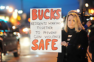 Marie Rosenberg of Lower Makefield, Pennsylvania holds up an anti gun violence sign during a candlelight vigil, as a sign of solidarity for the victims of last week's terror attack in California, Friday December 11, 2015 in Langhorne, Pennsylvania. (Photo by William Thomas Cain)