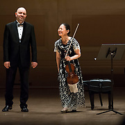 November 7, 2012 - New York, NY : Violinist Midori, right, and pianist Özgür Aydin take a bow after performing in the Stern Auditorium / Perelman Stage at Carnegie Hall on Wednesday night. CREDIT: Karsten Moran for The New York Times