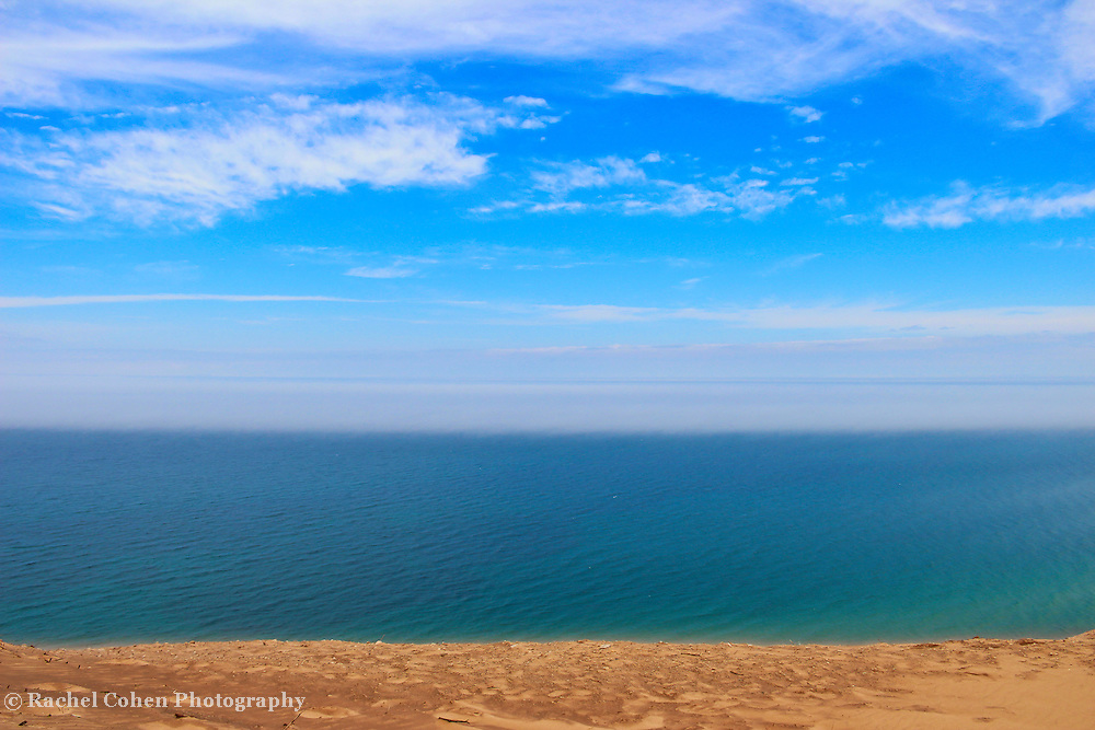 &quot;Earth Wind and Water&quot;<br /> <br /> Pure Michigan beauty in horizontal layers!<br /> Sand, blue water, fog, blue sky and clouds!<br /> The wonders of Lake Michigan!!<br /> <br /> The Great Lakes by Rachel Cohen