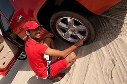Young Bahraini enjoying the desert of Bahrain withthe 4 wheel trucks, quads and cars, images taken in March 2010 during the F1 Grand Prix