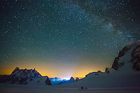 A long exposure photograph of starry sky as seen on a cold Summer night from a basecamp at Col du Midi, Chamonix, France.