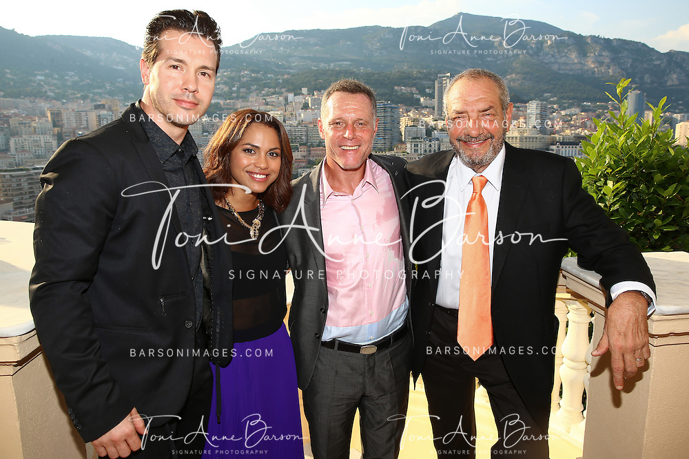 MONTE-CARLO, MONACO - JUNE 09:  (L-R) Jon Seda, Monica Raymund, Jason Beghe and Dick Wolf attend a Cocktail Reception at the Ministere d'etat on June 9, 2014 in Monte-Carlo, Monaco.  (Photo by Pool Barson/FilmMagic)