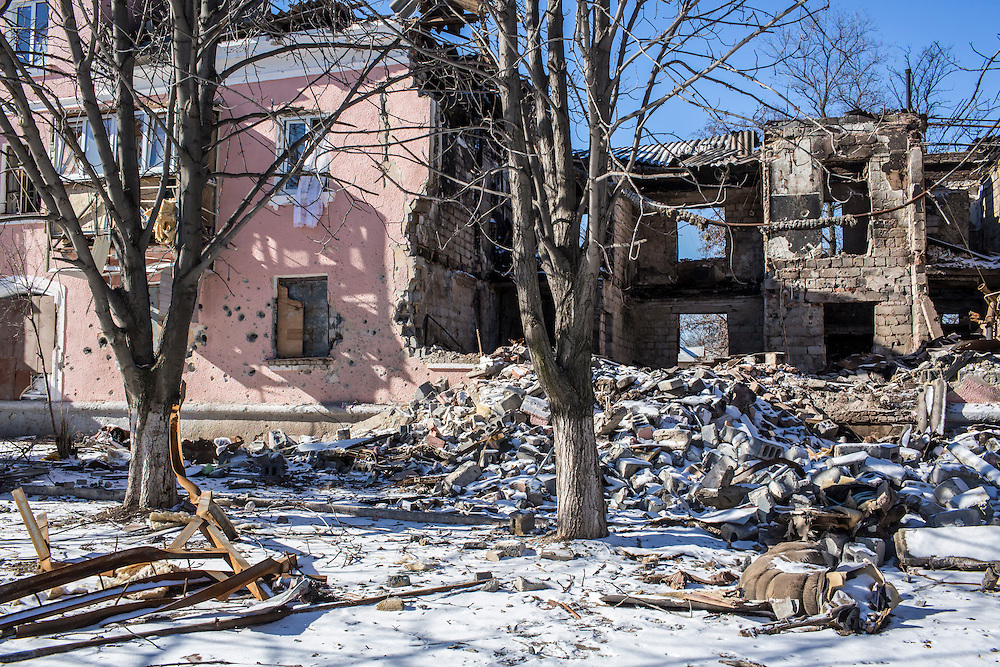 MYRONIVSKYI, UKRAINE - FEBRUARY 17: A building lies in ruins from being hit by a shell on February 17, 2015 in Myronivskyi, Ukraine. A ceasefire agreed to by Ukraine and pro-Russian rebel forces has failed to prevent fighting in the nearby town of Debaltseve, where thousands of Ukrainian troops remain and whom rebels claim to have surrounded. (Photo by Brendan Hoffman/Getty Images) *** Local Caption ***