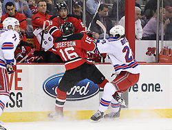 Mar 6; Newark, NJ, USA; New York Rangers center Brian Boyle (22) hits New Jersey Devils center Jacob Josefson (16) during the first period at the Prudential Center.