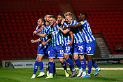 Players of Blackpool F.C. celebrate the goal scored by Armand Gnanduillet of Blackpool F.C. during the EFL Sky Bet League 1 match between Doncaster Rovers and Blackpool at the Keepmoat Stadium, Doncaster, England on 17 September 2019.
