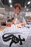 4/3/09 10:46:06 AM -- Easton, PA, U.S.A. -- Djoumile Pendeva, a seamstress at Majestic Athletic sews lettering on the back of a Chicago White Sox jersey April 3, 2009 in Easton, Pennsylvania. White Sox jerseys and gear have experienced a boost in sales with Obama, a White Sox fan, in the White House. -- .Photo by William Thomas Cain,  cainimages.com.