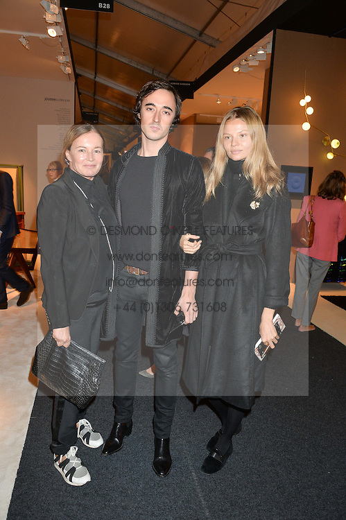 EVA CAVALLI, her son DANIELE CAVALLI and MAGDALENA FRACKOWIAK at the PAD London 2015 VIP evening held in the PAD Pavilion, Berkeley Square, London on 12th October 2015.