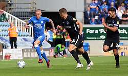 Joe Ward of Peterborough United gets away from Gareth Evans and Lee Brown of Portsmouth - Mandatory by-line: Joe Dent/JMP - 15/09/2018 - FOOTBALL - ABAX Stadium - Peterborough, England - Peterborough United v Portsmouth - Sky Bet League One