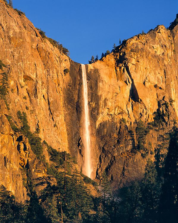 Bridal Veil Falls falls gently down the rock face into the valley at Yosemite NP, California, a World Heritage Site.