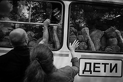 Russian conscript farewells with his relatives before he leaves to serve in the Russian army at a recruiting station in Moscow, Russia, 15 June 2012. The 2012 Spring draft calls for 155,000 young men to be called-up to complete their military service duties.