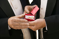 Groom and Father Holding Wedding Rings