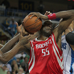 16 March 2009: Houston Rockets center Dikembe Mutombo (55) fights for possession of the ball with New Orleans Hornets defenders James Posey (41) and Tyson Chandler (6) during a NBA game between the New Orleans Hornets and the Houston Rockets at the New Orleans Arena in New Orleans, Louisiana.