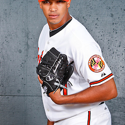 February 26, 2011; Sarasota, FL, USA; Baltimore Orioles pitcher Armando Gabino (61) poses during photo day at Ed Smith Stadium.  Mandatory Credit: Derick E. Hingle