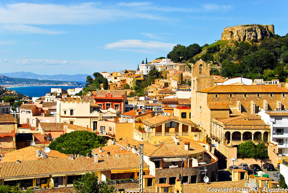 View of the hilltop city of Begur, Spain. Protecting the small city is the 16th to 17th century fort on top of the highest hill.