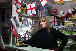 London, UK. 20 December, 2019. Cheryl Diamond prepares to close Syd's Coffee Stall for the very last time. The mahogany coffee stall, part of east London's history, has been run by three generations of the same family on the corner of Shoreditch High Street and Calvert Avenue since 1919 and will go on display in the new Museum of London in Smithfield in 2024.