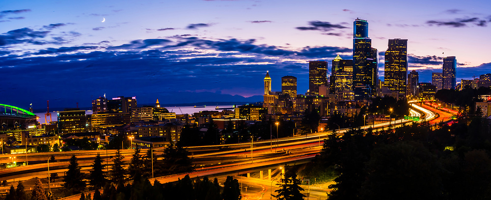 Twilight panoramic view of Interstate 5 in the foreground with Downtown Seattle behind, Washington State USA.