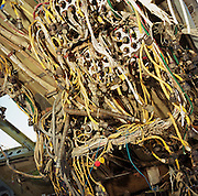 In the heat and dust of the arid Sonoran desert are the remains of a Boeing 747 cockpit at the storage facility at Mojave, California. The wiring of the now-extinct flight engineer's console is a jumble of old technology. Either by age or cooling economy airliners are either cannibalised for still-working parts or recycled for scrap, their aluminium fuselages worth more than their sum total. Elsewhere, assorted aircraft wrecks sit abandoned in the scrub minus their bellies, legs or wings like dying birds. After a lifetime of safe commercial flight, wings are clipped and cockpits sliced apart by huge guillotines, cutting through their once-magnificent engineering. Picture from the 'Plane Pictures' project, a celebration of aviation aesthetics and flying culture, 100 years after the Wright brothers first 12 seconds/120 feet powered flight at Kitty Hawk,1903..