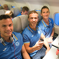 Rosenborg v St Johnstone....18.07.13  UEFA Europa League Qualifier.<br /> Gary Miller, Chris Millar and Gary McDonald all smiles on the flight home from Trondheim after saints beat Rosenborg<br /> Picture by Graeme Hart.<br /> Copyright Perthshire Picture Agency<br /> Tel: 01738 623350  Mobile: 07990 594431
