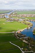 Nederland, Noord-Holland, Nigtevecht, 16-04-2008; de rivier de Vecht meandert en mondt bij Nigtevecht uit in het Amsterdam-Rijnkanaal; verschillende polders aan weerszijden van het riviertje; Zuid-as Amsterdam links aan de horizon, rechts Amsterdam Zuidoost; watermolen, meander  ..luchtfoto (toeslag); aerial photo (additional fee required); .foto Siebe Swart / photo Siebe Swart.