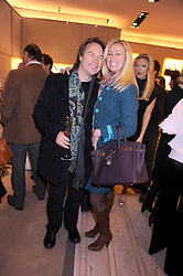 JOHN HITCHCOX and JENNY HALPERN-PRINCE at a party at Roger Vivier, Sloane Street, London on 2nd December 2008.