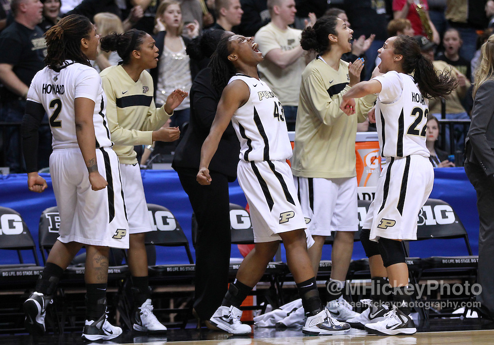 March 04, 2012; Indianapolis, IN, USA; Members of the Purdue Boilermakers celebrate against the Nebraska Cornhuskers during the finals of the 2012 Big Ten Tournament at Bankers Life Fieldhouse. Purdue defeated Nebraska 74-70 in 2OT. Mandatory credit: Michael Hickey-US PRESSWIRE