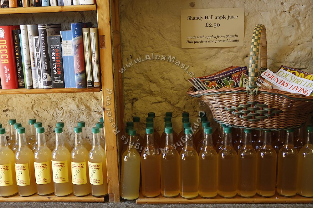Apple juice bottles are on sale inside a shot at Shandy Hall, in Coxwold, Yorkshire, England, United Kingdom.